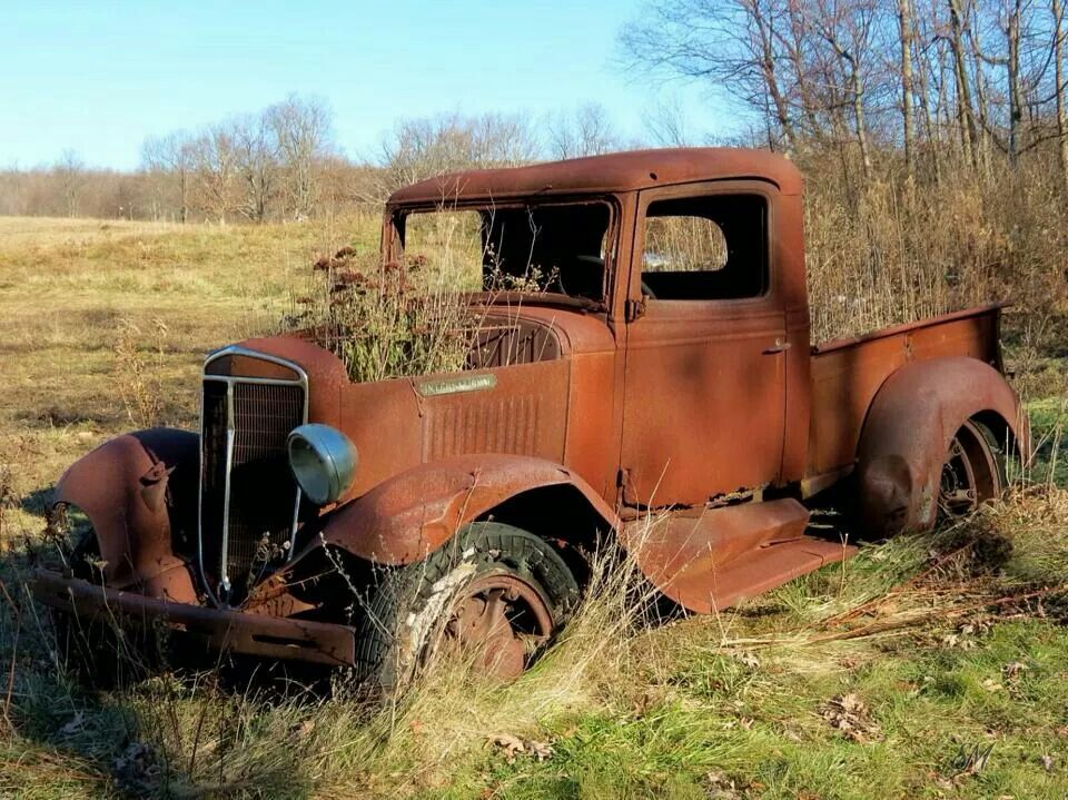 being taken over by nature in West Virginia Old trucks