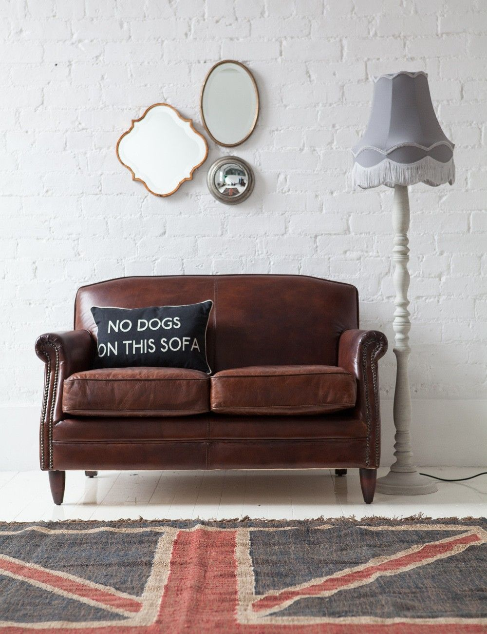 Brown Leather Sofa With Uk Rug
