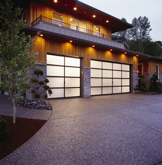Clopay Avante Collection Garage Doors Bronze Aluminum Frame With Frosted Glass Panels Www Clopaydoo Garage Doors Contemporary Garage Doors Garage Door Design