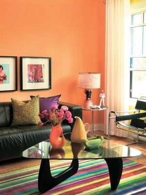 A Wall Painted In Tangerine Tango An Exuberant Orange Tone Adds The Wow Factor To Living Room