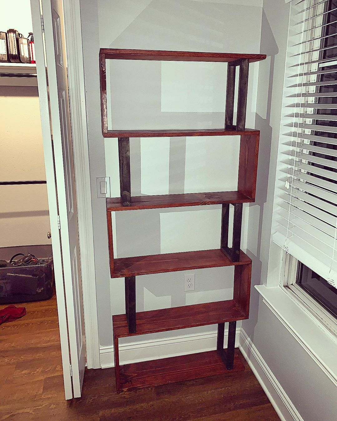 I had a friend who wanted a sleek, modern bookcase to fit this space in his apartment. The contrast between the ebony squares and honey shelves really make this piece pop. I really had a great time making this and my friend even gave a helping hand too  #woodworking #wood #handmade #woodwork #diy #design #art #woodworker #interiordesign #woodart #furniture #carpentry #homedecor #woodshop #woodcraft #wooddesign #carpenter #wooden #woodturning #maker #woodcarving #handcrafted #architecture #interi