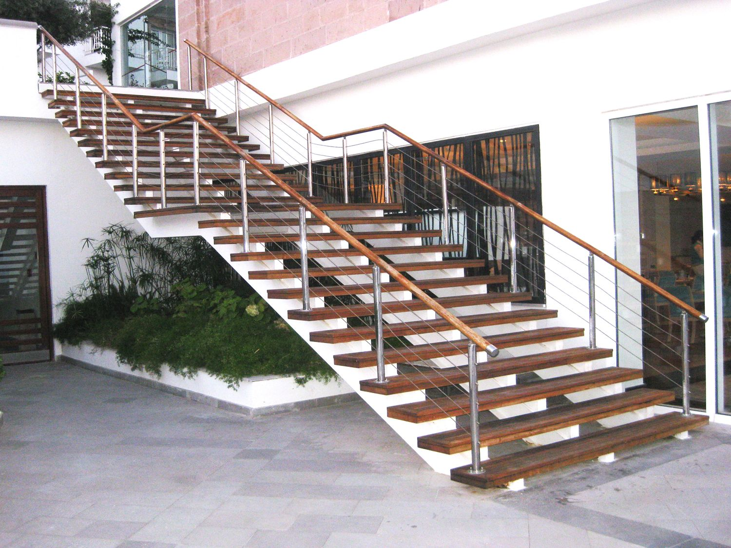 Great For Indoor And Outdoor Applications Our Steel Cable Railing Provides A Modern Solution That Is Staircase Design Stainless Steel Staircase Modern Stairs