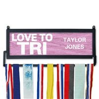 TriForever Our custom love to tri medal hanger is the perfect way to display your sprint tri, Olympic tri, half Ironman and full Ironman medals. The design features our courage artwork and space for personalization for a unique medal hanger