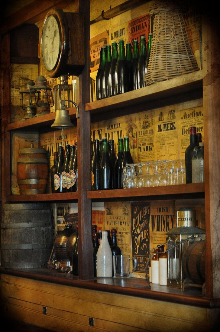 Stock: Historic Vintage Old Tavern Bar Back Wall With Glass Bottles, Lamps,  Glasses And Barrels. Rustic Old Bar