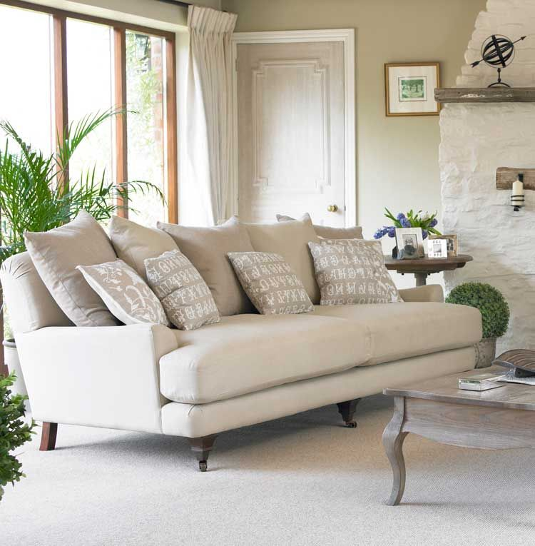 A contemporary twist on a vintage French design. The Brittany sofa is deep and low and looks stunning with an excess of scatter cushions - you can use all your favourite fabrics - and the one-and-a-half seater loveseat makes a wonderful wide cuddling chair.