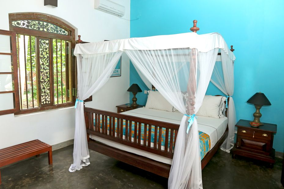 Villa Sepalika - Le lit de la chambre bleue