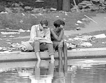 Two demonstrators linger at the Reflecting Pool at the end of the day's events.