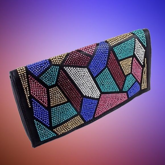 Black Multi-colored Crystal Rhinestone Clutch Colored crystals on front flap. Back is solid black with a bit of sparkle. 2 snaps. Zipper enclosure. Zippered pocket within. Silver chain. Bags