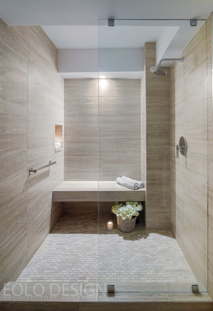 This stunning shower with an elegant neutral palette was completed