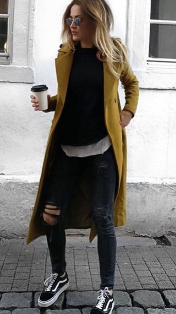 Classic coat over trendy casual outfit.
