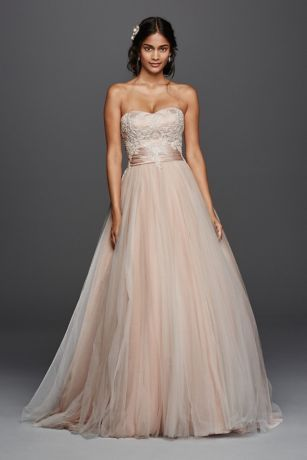1c6d4f4c34be Strapless tulle ball gown shown in Ivory and Blush. The bodice features a  sweetheart neckline and beautifully embellished beaded lace.