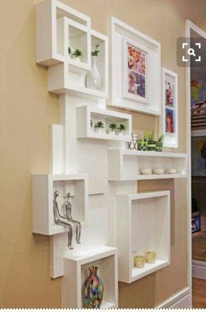 Random Seeming Boxes And Shelves Make Great Focal Point Storage.