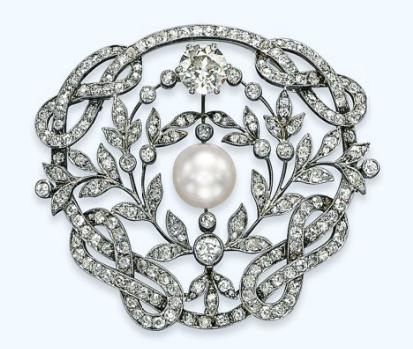 A BELLE EPOQUE NATURAL PEARL AND DIAMOND BROOCH, circa 1900s.  Christie's Magnificent Jewel Auction, Geneva, Nov 2013.