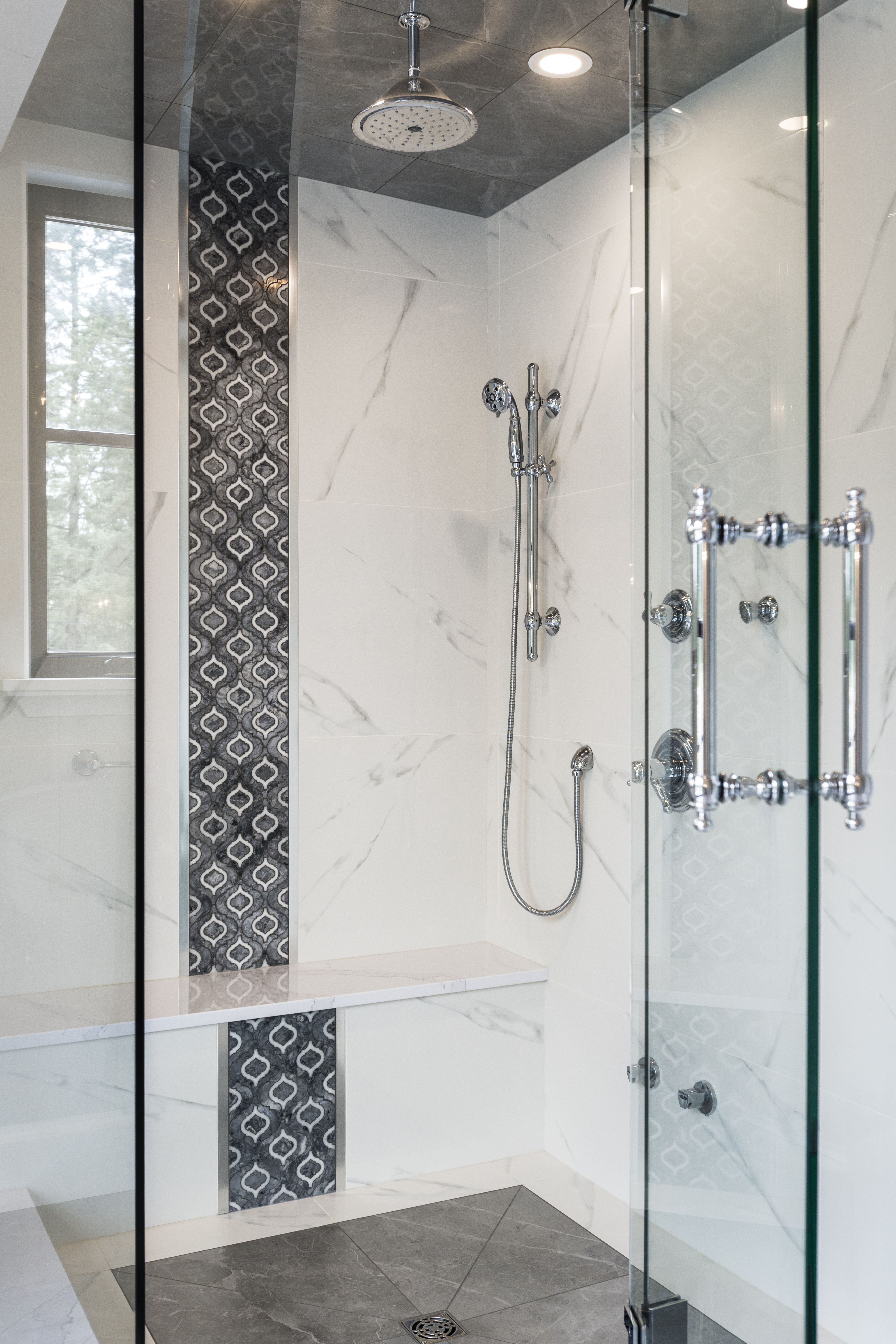 Steam shower with arabesque shaped tiles for the feature strip ...