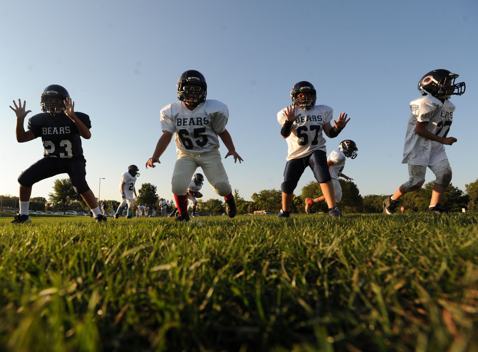 The under-8 Ames junior Bears football team practices at the Ames High Football practice field on Tuesday evening. Photo by Nirmalendu Majumdar/Ames Tribune