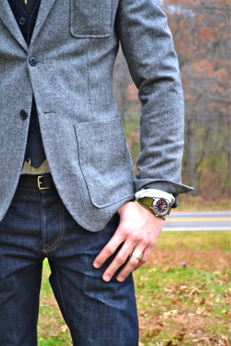 Gray jacket with patch pockets & functional sleeve buttons.