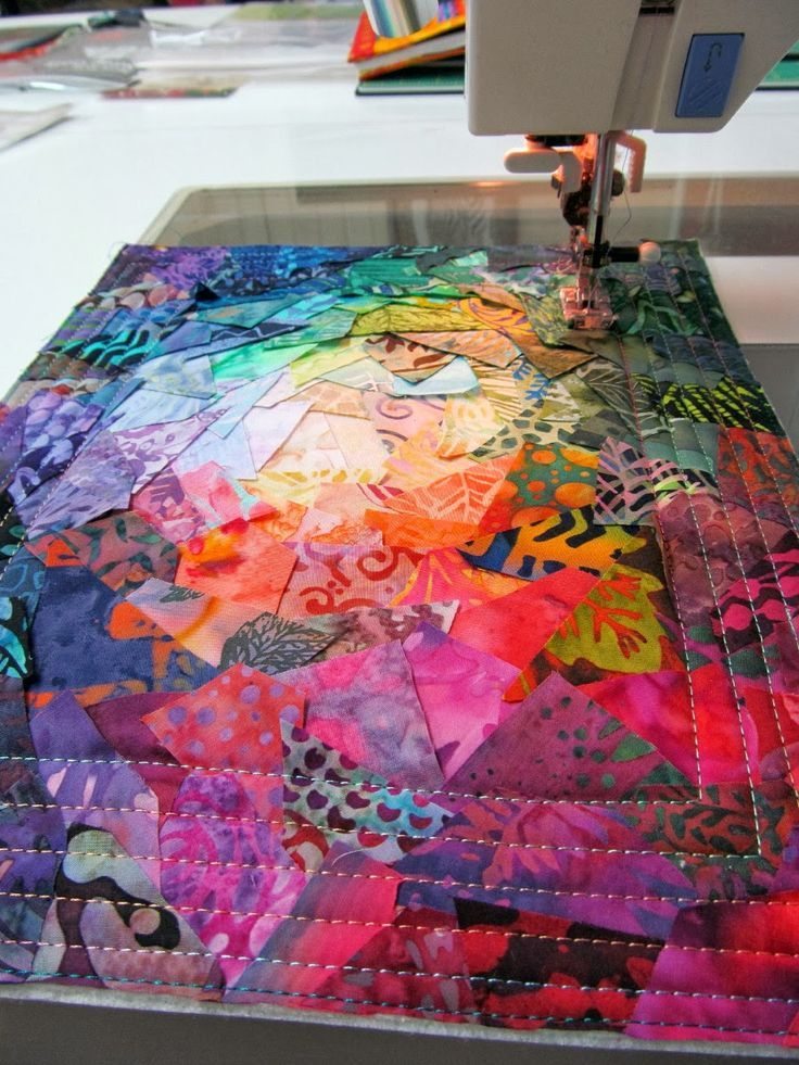 This confetti art quilt is an explosion of color .  Quilted colorful pieces.