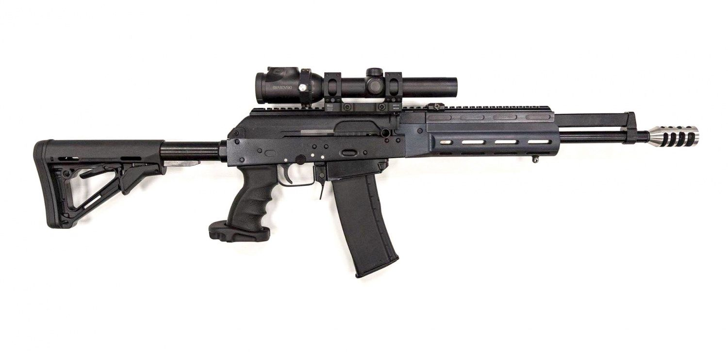 """Saiga MK-107 is a semi-automatic gas operated rifle with recoil-mitigating balanced action. This means that rifle features two gas pistons, entering a single gas block above the barrel from opposite directions."""""""