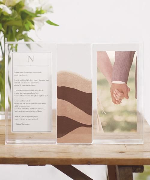This unique sand ceremony shadow box includes a separate central compartment for the bride and groom to fill with sand as well as two flanking compartments intended to include photos or printed messages that are meaningful to the couple.