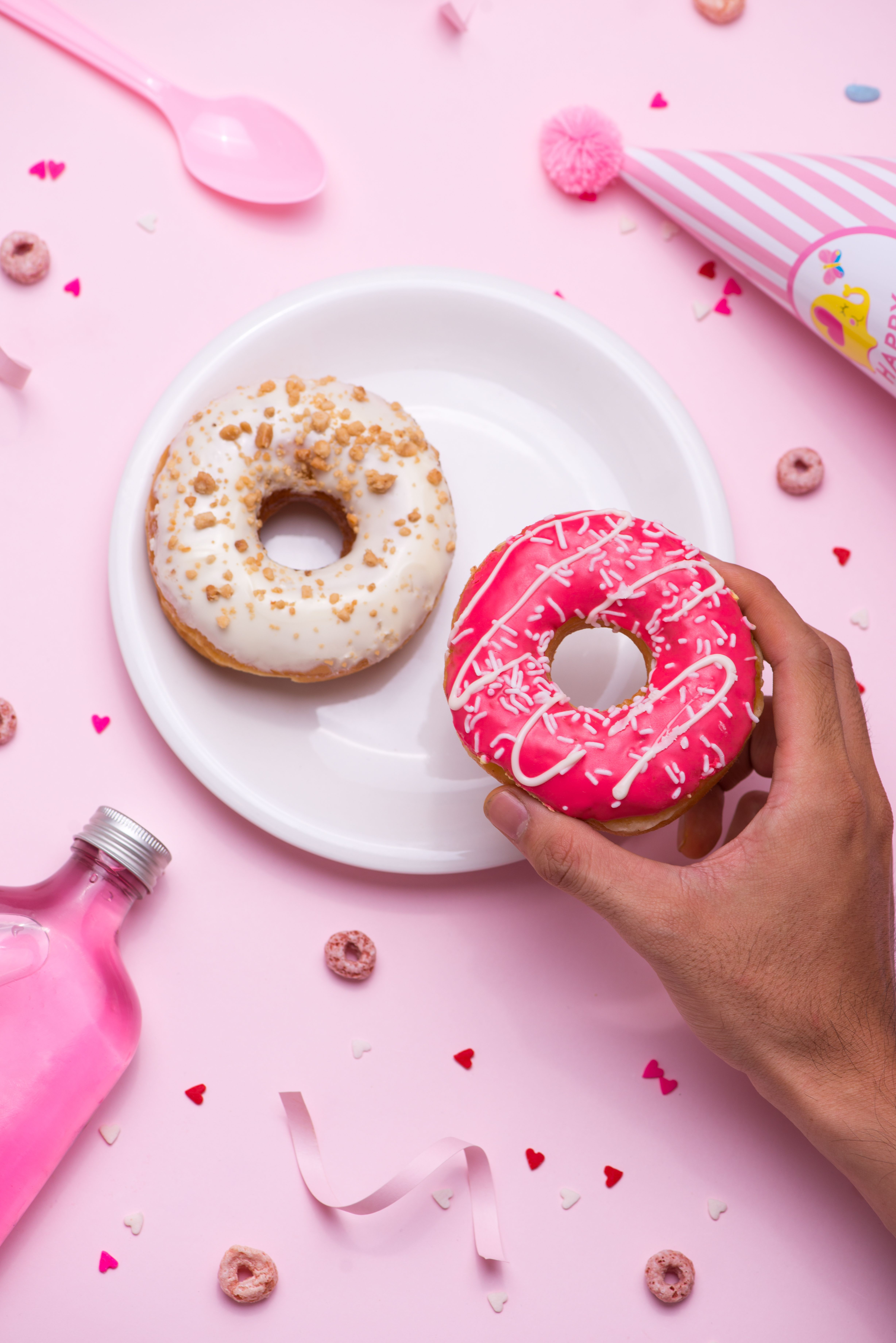 d18343101 Hands off! We love pink doughnuts far too much!