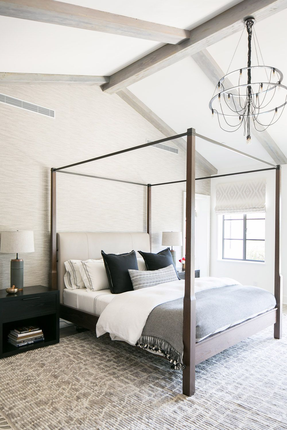 Canopy Bed In The Master Bedroom Large Rug In The Bedroom Wooden Beams On A Vaulted Ceiling Vaulted Ceiling Bedroom Modern Bedroom Wooden Bedroom Furniture