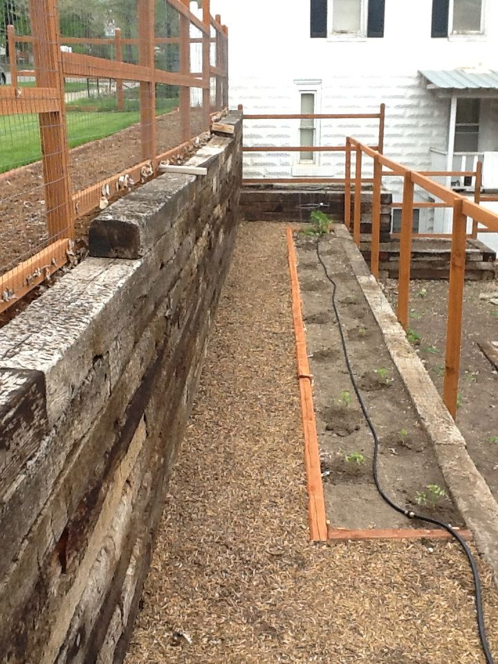 Railroad Tie Retaining Wall And Tomato Garden Landscaping Retaining Walls Backyard Landscaping Railroad Tie Retaining Wall