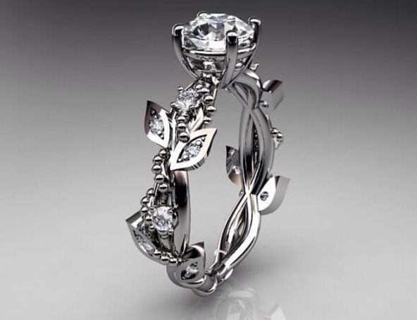 beautiful rose shaped ring would change the stone for a ruby though - Rose Shaped Wedding Ring