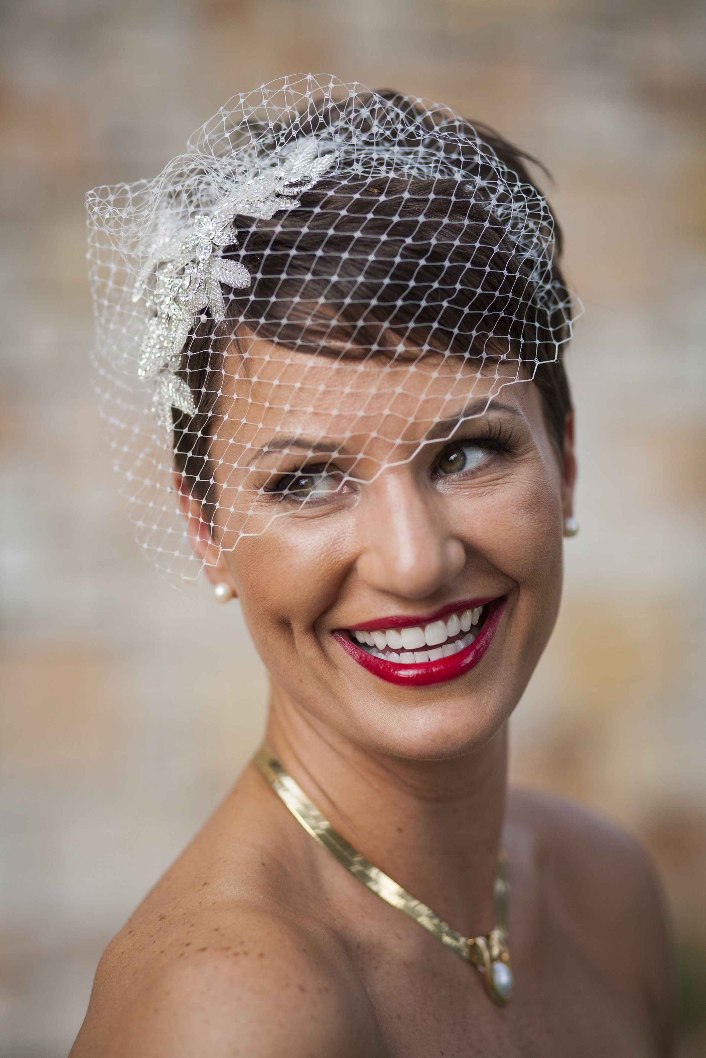 For short hair, dressed up with a birdcage veil. Hair by