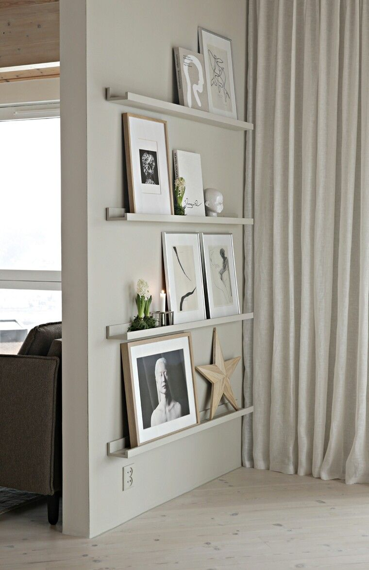 Photo of Frame shelves painted same as wall.