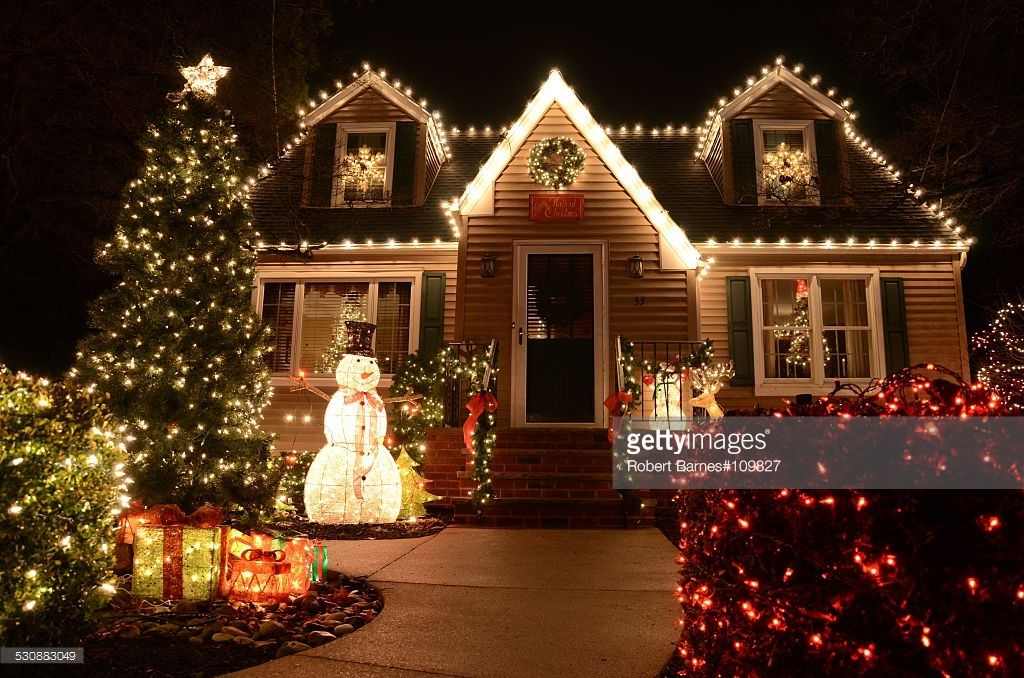 A Small Cape Cod Style House Outlined With White Christmas Lights And Outside Christmas Decorations Christmas Lights Decorating With Christmas Lights