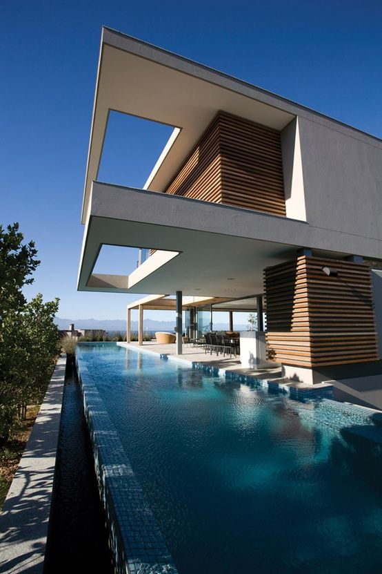 """This seaside home is located in Plettenberg Bay, South Africa and is designed by 'Saota - Stefan Antoni Olmesdahl Truen Architects'.    The clients requested a 6-bedroomed family home with understated elegance and quiet grandeur, indoor / outdoor living spaces and uninterrupted views, with a """"lived-in beach-house"""" feel."""