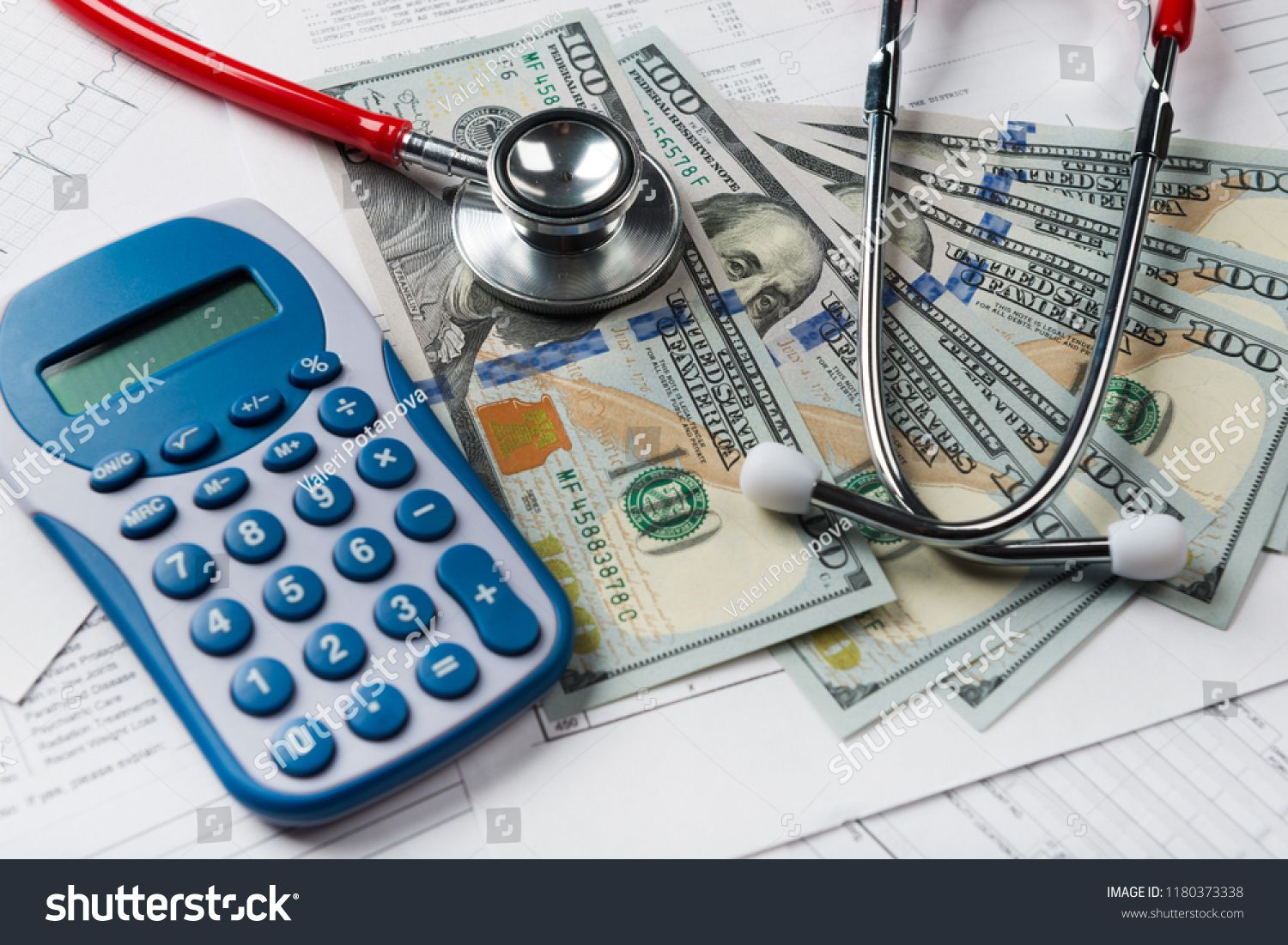 Health care costs stethoscope and calculator symbol for