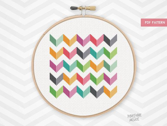 """Stitch this bright colorful chevron counted cross stitch pattern. Make this as an abstract geometric gift or a modern home decor wall hanging for yourself. This makes a great de-stash project for an advanced stitcher. Because this pattern only uses whole stitches, it is also easy for a beginner to tackle. The pattern is 75 by 75 stitches. Make sure to buy your aida cloth with a few inches extra for a border.  14 count aida – 5 ½"""" x 5 ½"""" (13.61 x 13.61cm)  16 count aida – 4 ¾"""" x 4 ¾"""" (11.91 x…"""