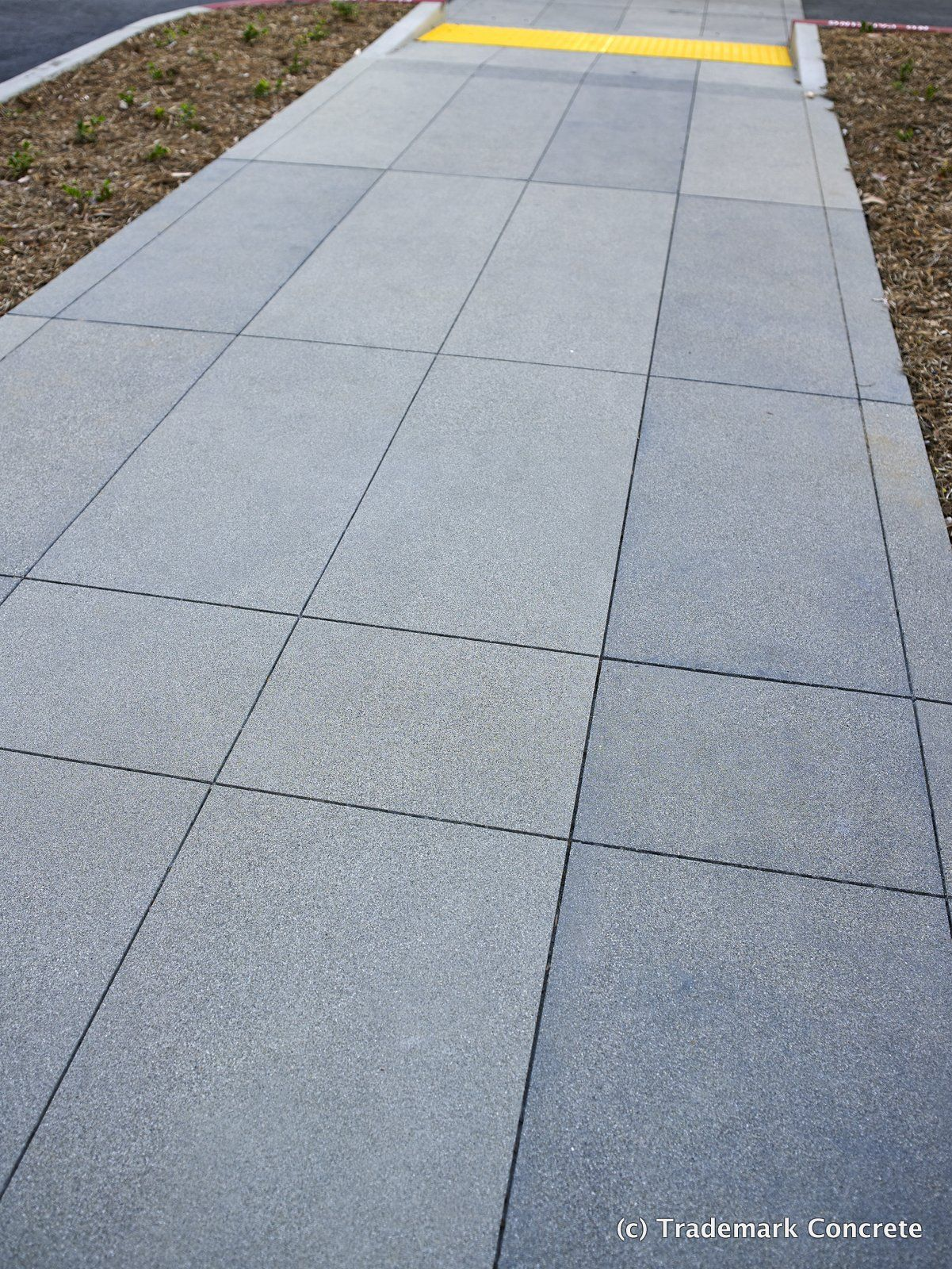 Decorative concrete installed by dcc member trademark concrete sawcut grid pattern various integral colors all with a sand finish at the hca hospital in