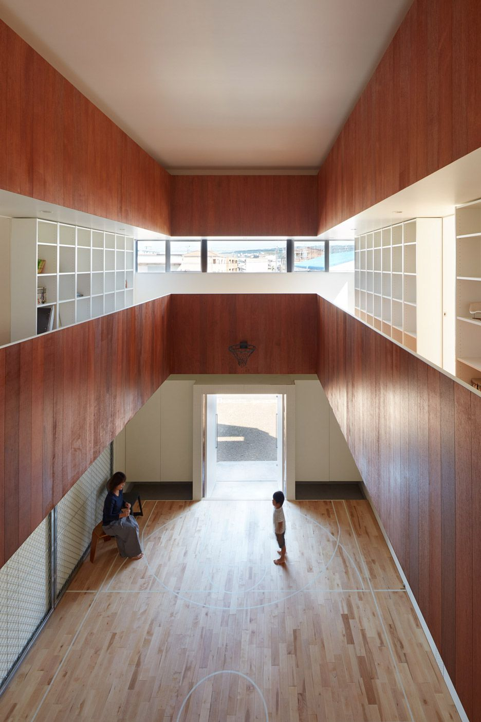 An Indoor Basketball Court Forms The Atrium Of This Family Home In Eastern Japan Home Basketball Court Indoor Basketball Court House