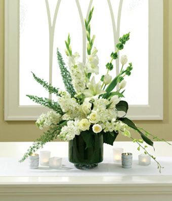 Gladiolus Arrangment Ideas Accent The Wedding Altar With A Beautiful Display Of Tulips Orchids White Flower Arrangements Altar Flowers Wedding Altar Flowers