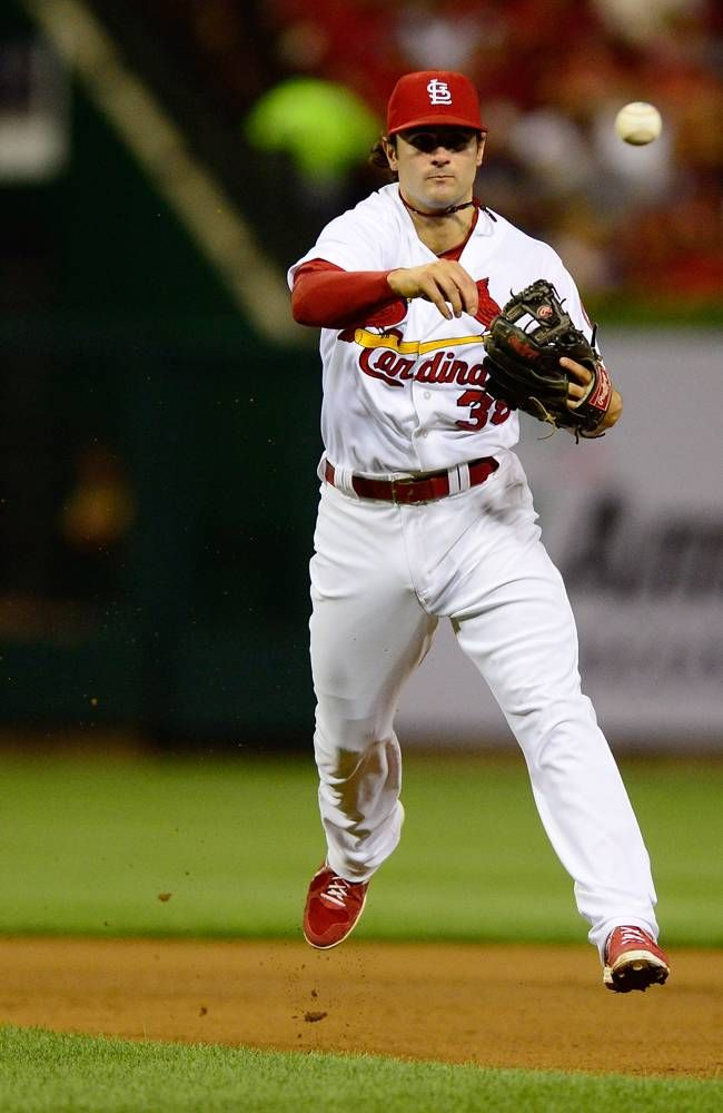 ST. LOUIS, MO - AUGUST 6: Pete Kozma #38 of the St. Louis Cardinals throws out Clayton Kershaw #22 of the Los Angeles Dodgers during the fifth inning at Busch Stadium on August 6, 2013 in St. Louis, Missouri. (Photo by Jeff Curry/Getty Images)
