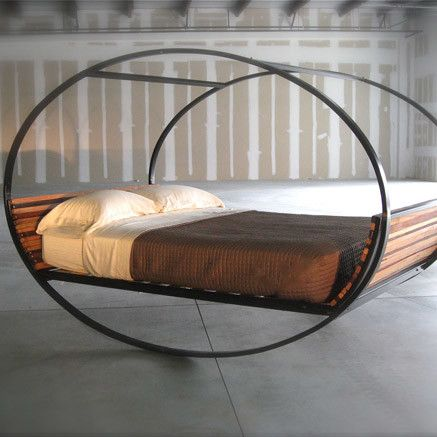 canopy bed -- very cool looking, but would you roll across the room while you sleep?