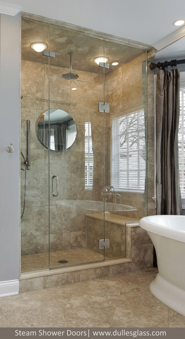 This luxury shower door features a door and two panels. One of the ...