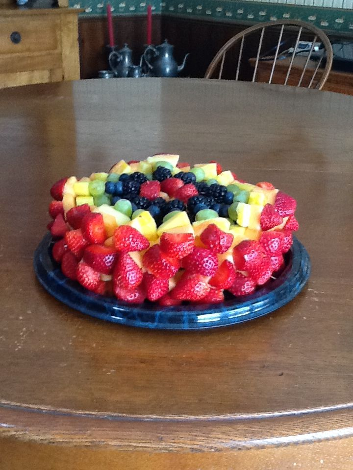 Fruit skewer cake made with strawberries cantaloupe