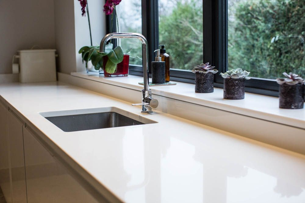 inlaid sink within a white quartz natural stone worktop with a rh pinterest com