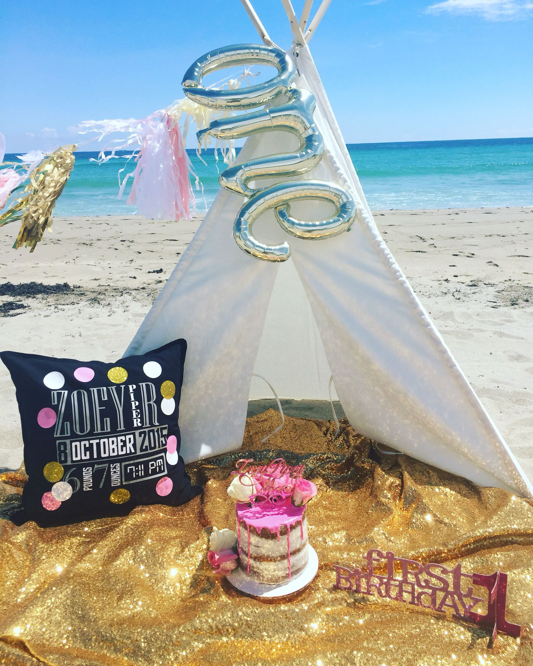Zoeys smash cake . Kidchella teepee tent gold sequins naked cake . Mirror topper. Stat pillow .