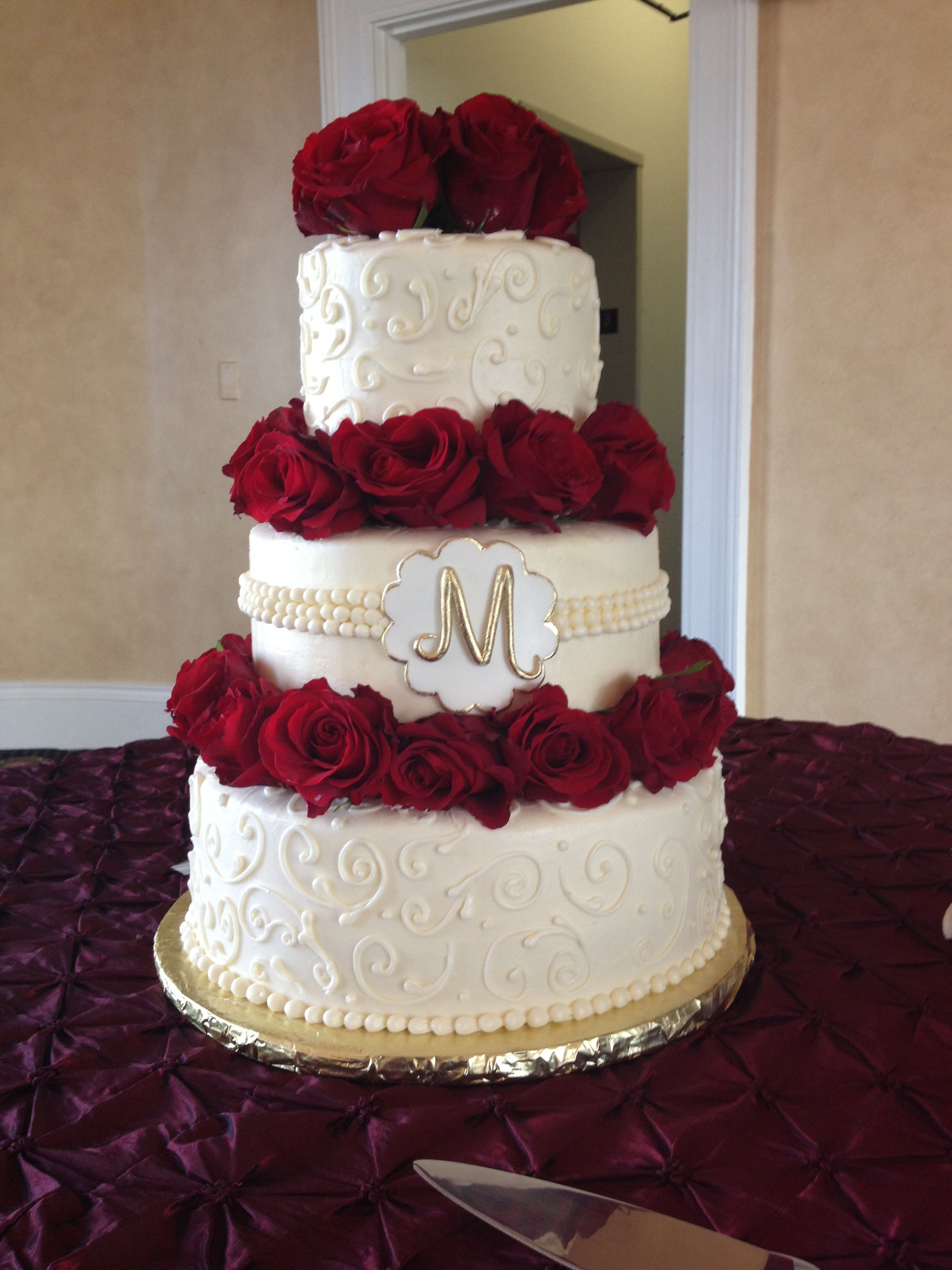 Red rose and Gold accent buttercream wedding cake  Wedding cake     Red rose and Gold accent buttercream wedding cake  Wedding cake delivered  to The Italian Club in Tampa Florida