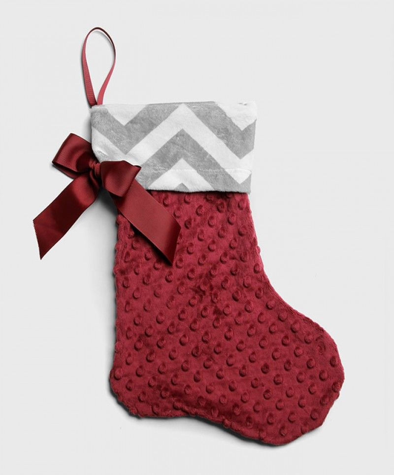 This ultra soft stocking has a 3D dot pattern on the maroon lower half and a grey and white chevron pattern on the top. The stocking also has a maroon bow on the side. Made of 100% Polyester.