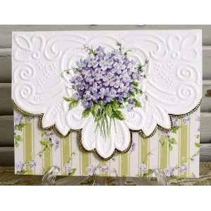 Billede fra http://img0072.psstatic.com/151976305_carol-wilson-violets-note-card-portfolio-10-ct.jpg.