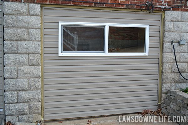 Replacing An Old Garage Door With A Wall Lansdowne Life Garage Doors Garage Door Styles Garage Door Types