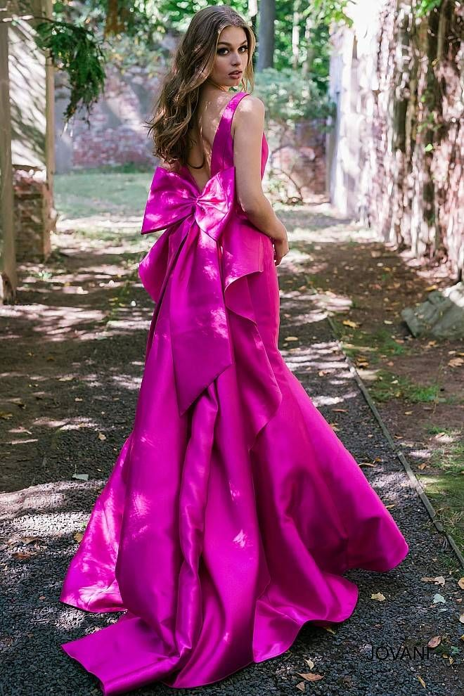 c438f5dd152a Elegant fuchsia sleeveless floor length mermaid prom gown with v neckline  and back features bow detail on the back and a train, available also in  black, ...
