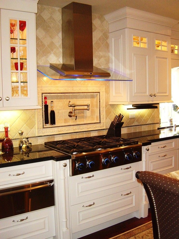dazzling pot filler faucet in kitchen with dacor range next to shelf above stove alongside