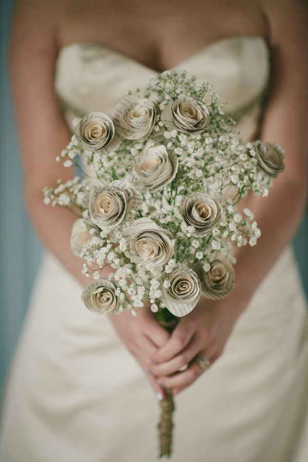 A bouquet made out of book-page roses laced with baby\'s breath ...