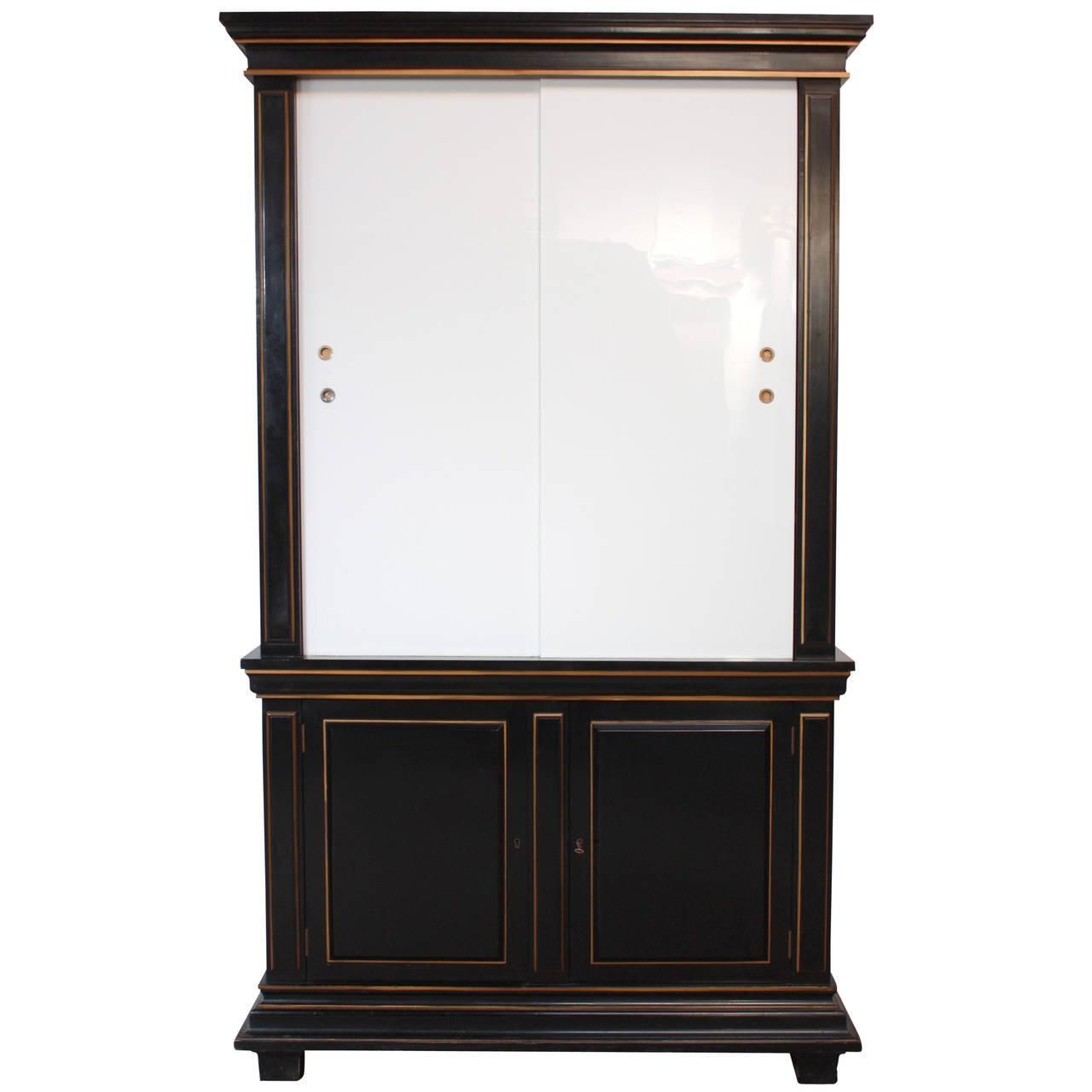 For Sale On   This Majestic Armoire In The Style Of James Mont Features Two  Sliding Milk Glass Doors, A Black Lacquered Frame, Three Adjustable Shelves  On ...